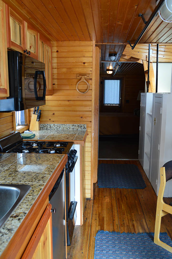 Kitchenette in blue caboose - Cabin Rentals in Glacier