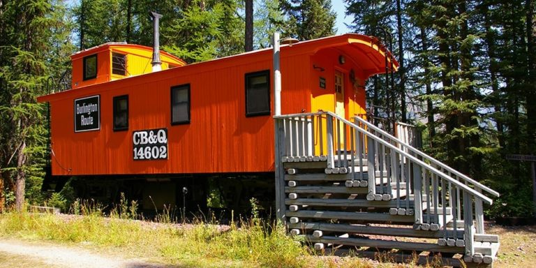 Outside of Orange Caboose at Izaak Walton - Cabin Rentals in Glacier