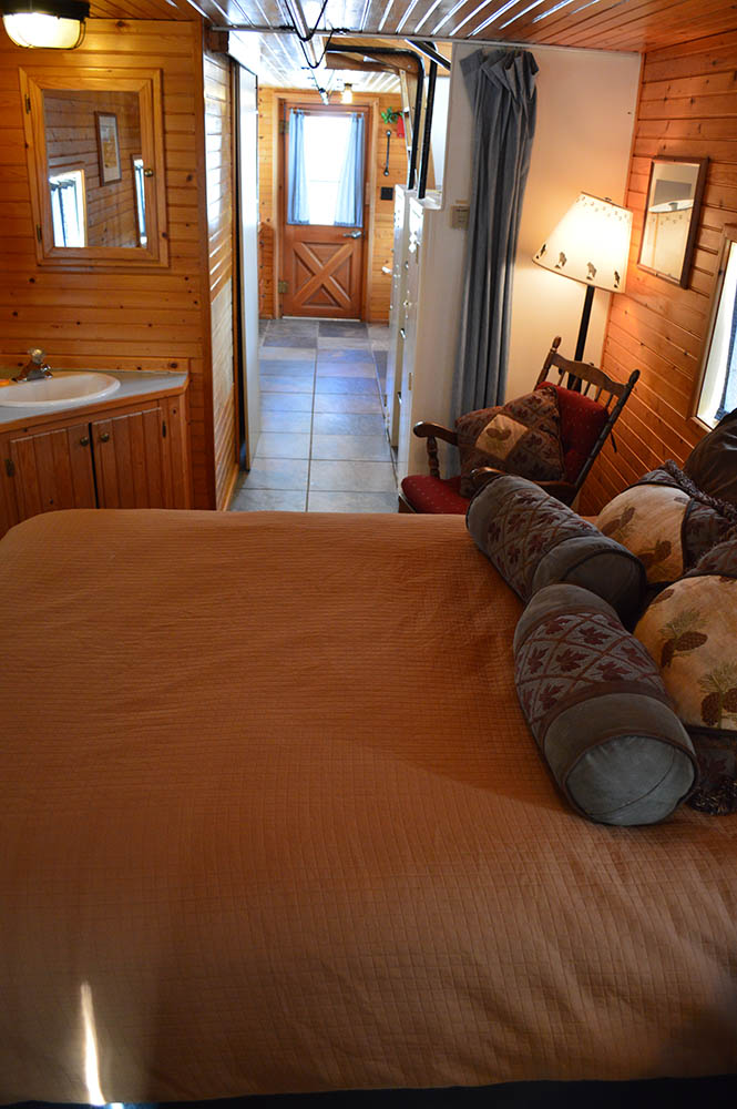 Orange caboose bedroom at Izaak Walton Inn - Cabin Rentals in Glacier