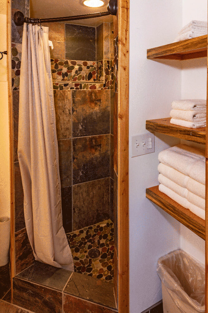 Shower in river caboose - Cabin Rentals in Glacier