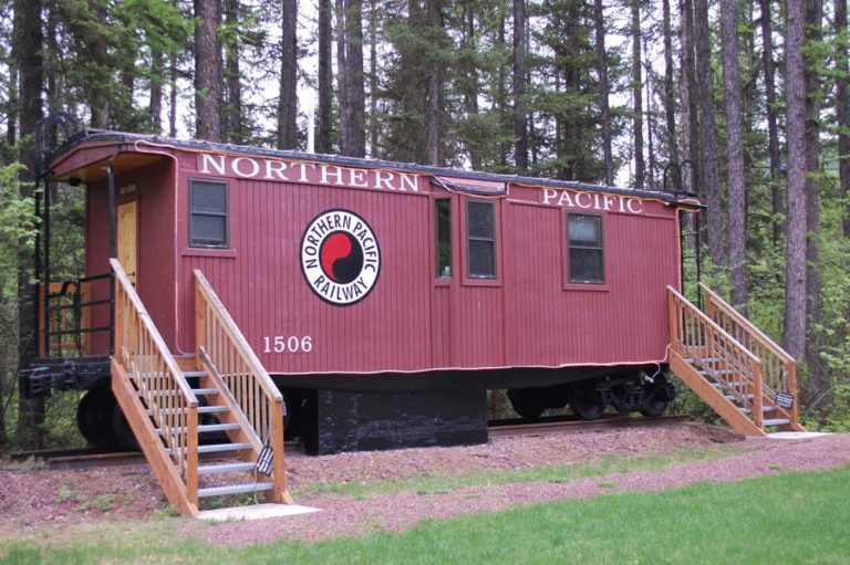 Front of northern caboose located at Izaak Walton Inn - Luxury Cabins Near Glacier National Park