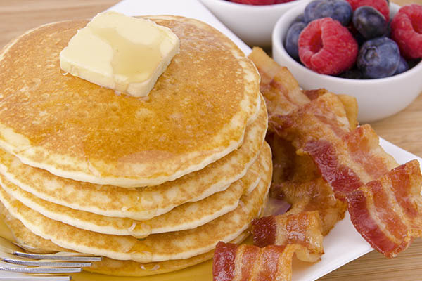 Full stack of pancakes, bacon and fruit - Glacier National Park Resort